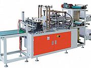 Двухуровневый полуавтоматический станок для производства одноразовых ПЭ перчаток VXZ-500 Москва